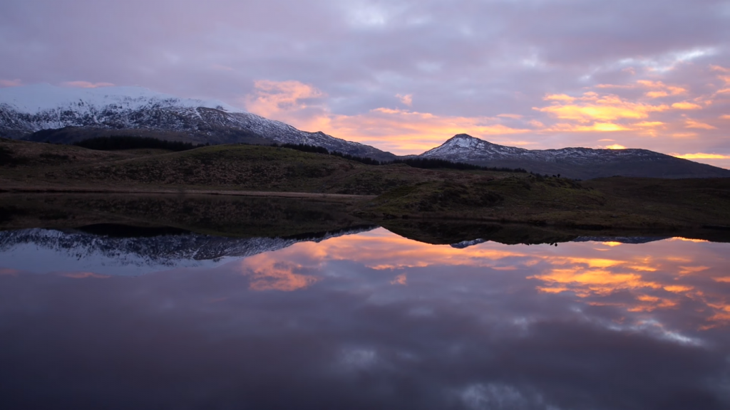 The sun rises over Snowdonia near our log cabins Wales